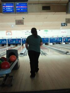 Miss Neenee taking a bowl down the lane.