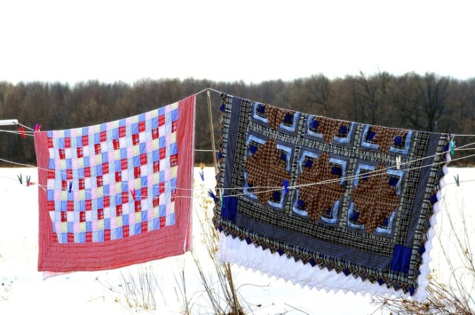 quilts on clothes line snow