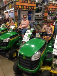 Kids on the lawn mowers at the local Lowe's