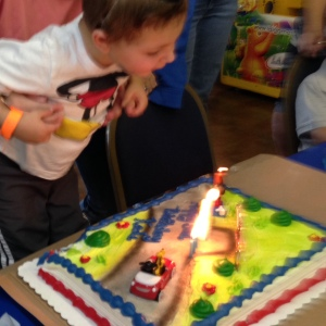 Mr. Sweetie Pants blew out the candles on his Mickey Mouse cake like a boss