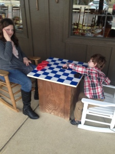 My sweeties playing checkers at the Cracker Barrel